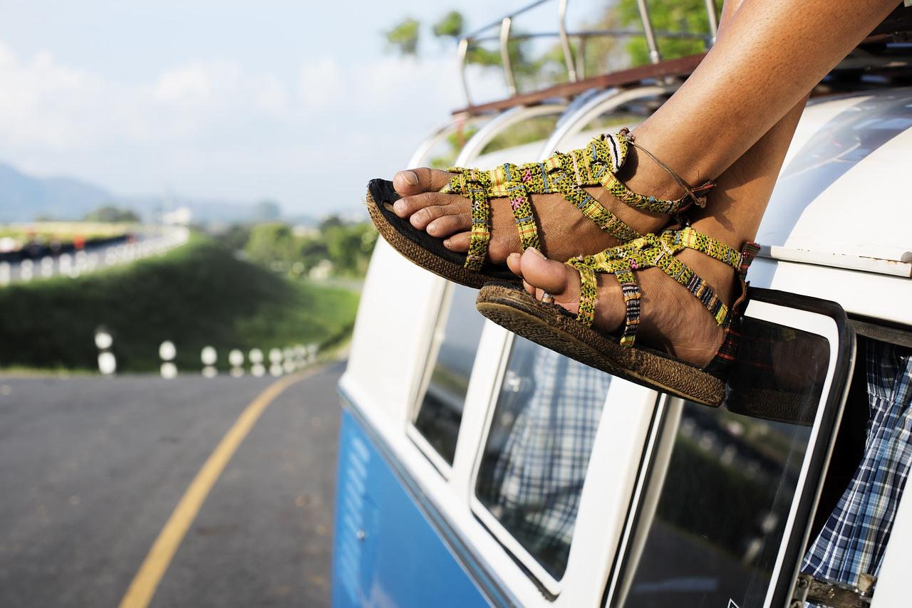 Crossed Legs Sitting on top of Van